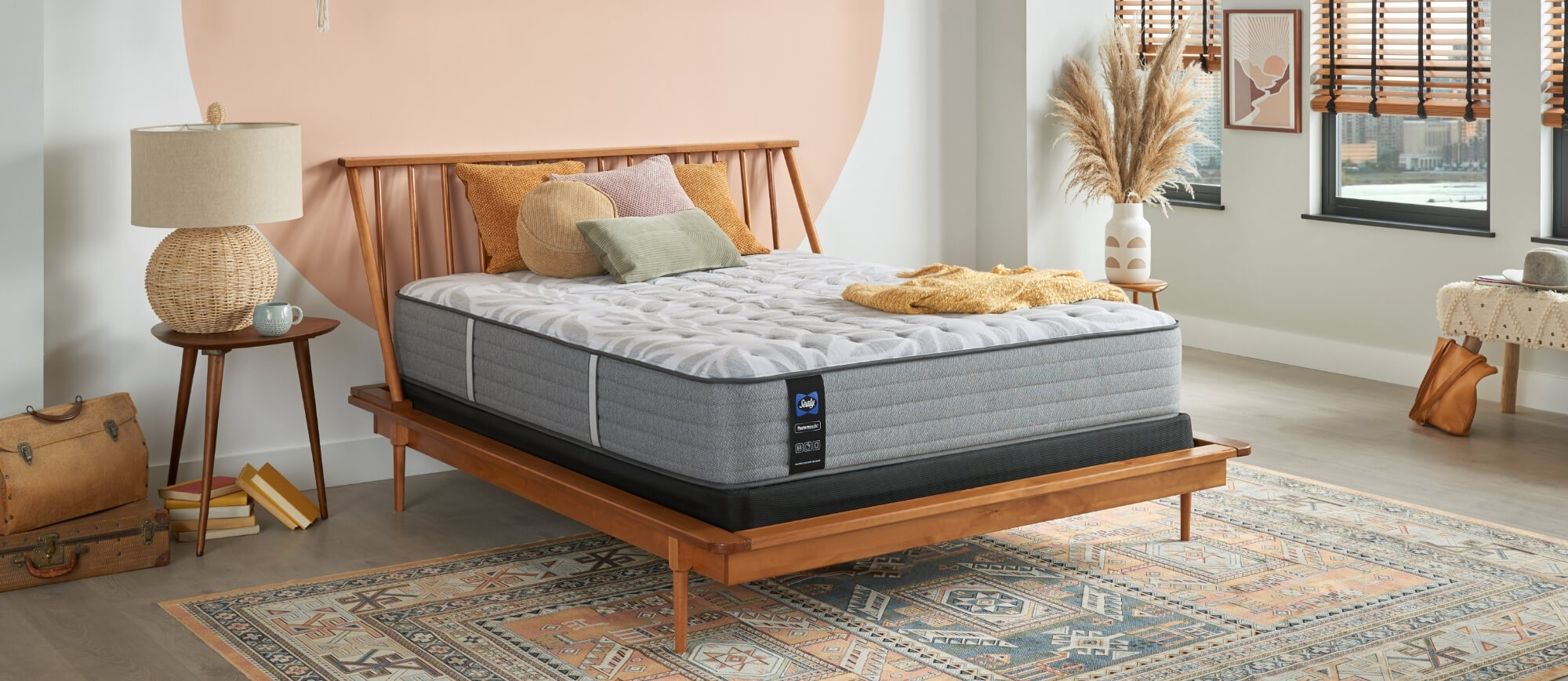 An advanced Posturepedic mattress in a styled room