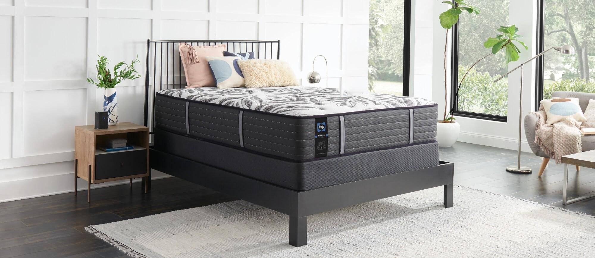 A Posturepedic Plus mattress in a styled mattress
