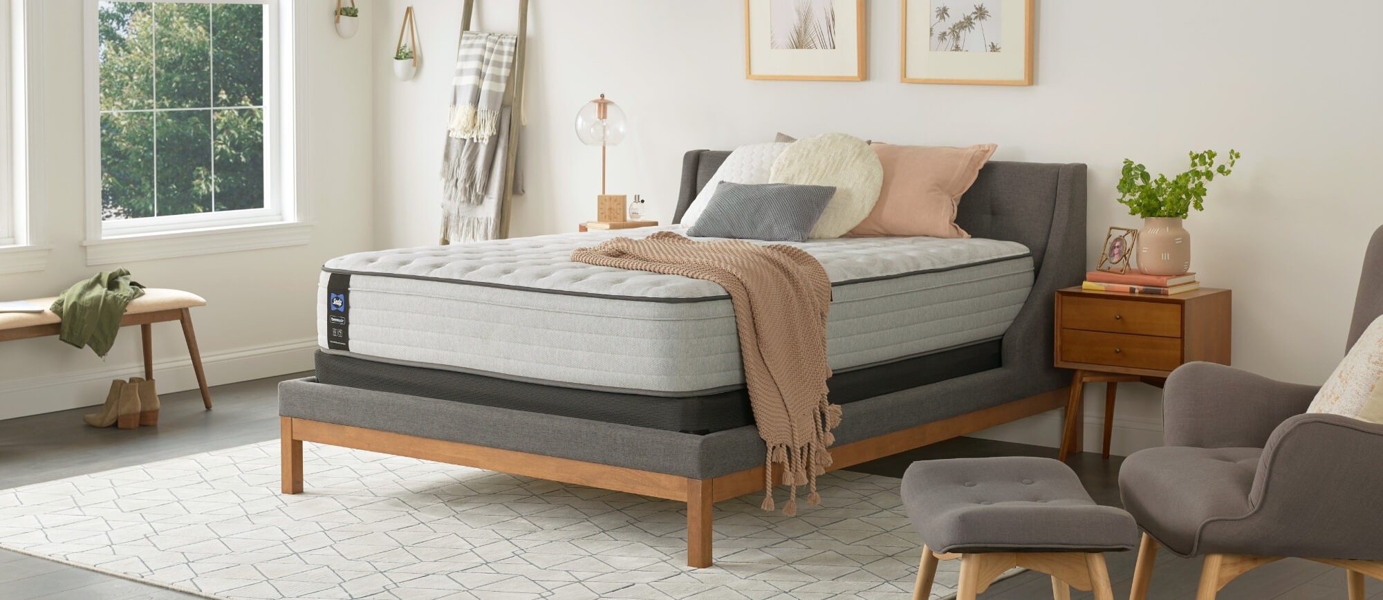 A Posturepedic mattress in a styled room
