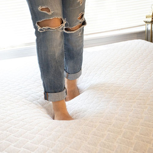 Woman Walking Across Sealy Express Mattress- Showing Medium Soft Feel