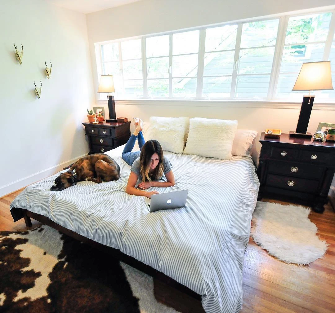 woman-laying-on-king-size-cocoon-mattress-with-dog